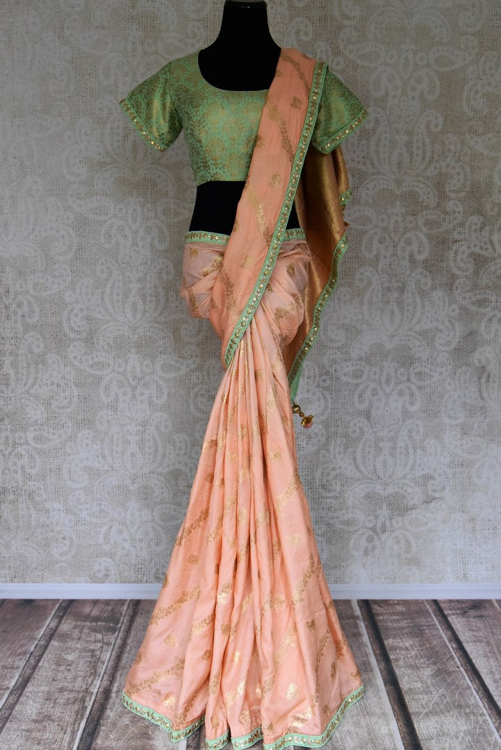 Shop peach tussar georgette saree online in USA with gota work border and saree blouse. Be the talk of every occasion in beautiful Indian designer saris, pure silk sarees, Banarasi sarees from Pure Elegance clothing fashion store in USA this wedding season.-full view