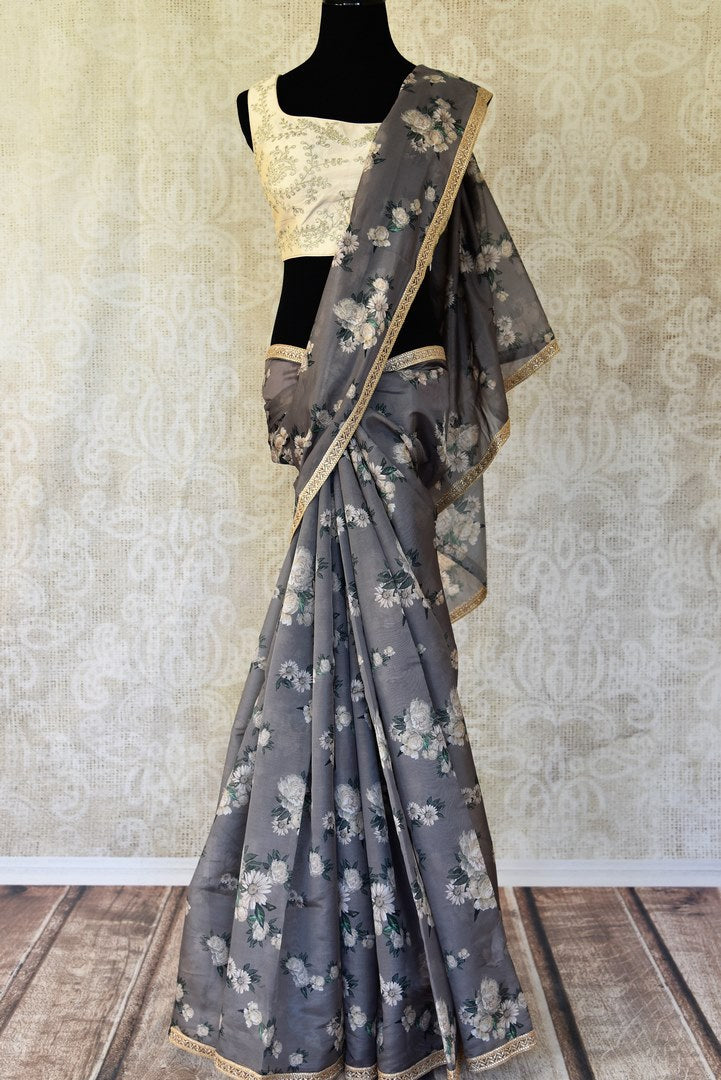 Buy grey floral print embroidered silk saree with sleeveless blouse online in USA from Pure Elegance. Be an epitome of Indian fashion on special occasions with beautiful designer sarees with blouses, Banarasi sarees, Kanchipuram silk saris available at our Indian fashion store in USA. -full view