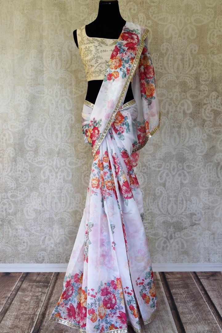 Shop white floral print silk saree with gota border and saree blouse online in USA from Pure Elegance. Be an epitome of Indian fashion on special occasions with beautiful designer sarees with blouses, Banarasi sarees, Kanchipuram silk saris available at our Indian fashion store in USA. -full view