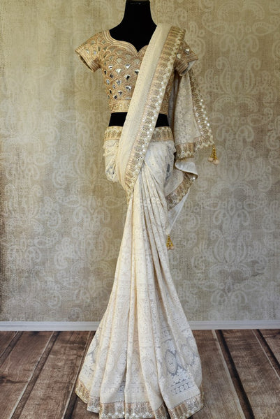 Shop off-white Lucknowi embroidery saree with designer blouse online in USA. Shop more such Indian designer saris, embroidered sarees, pure silk sarees in USA from Pure Elegance clothing fashion store this wedding season.-full view