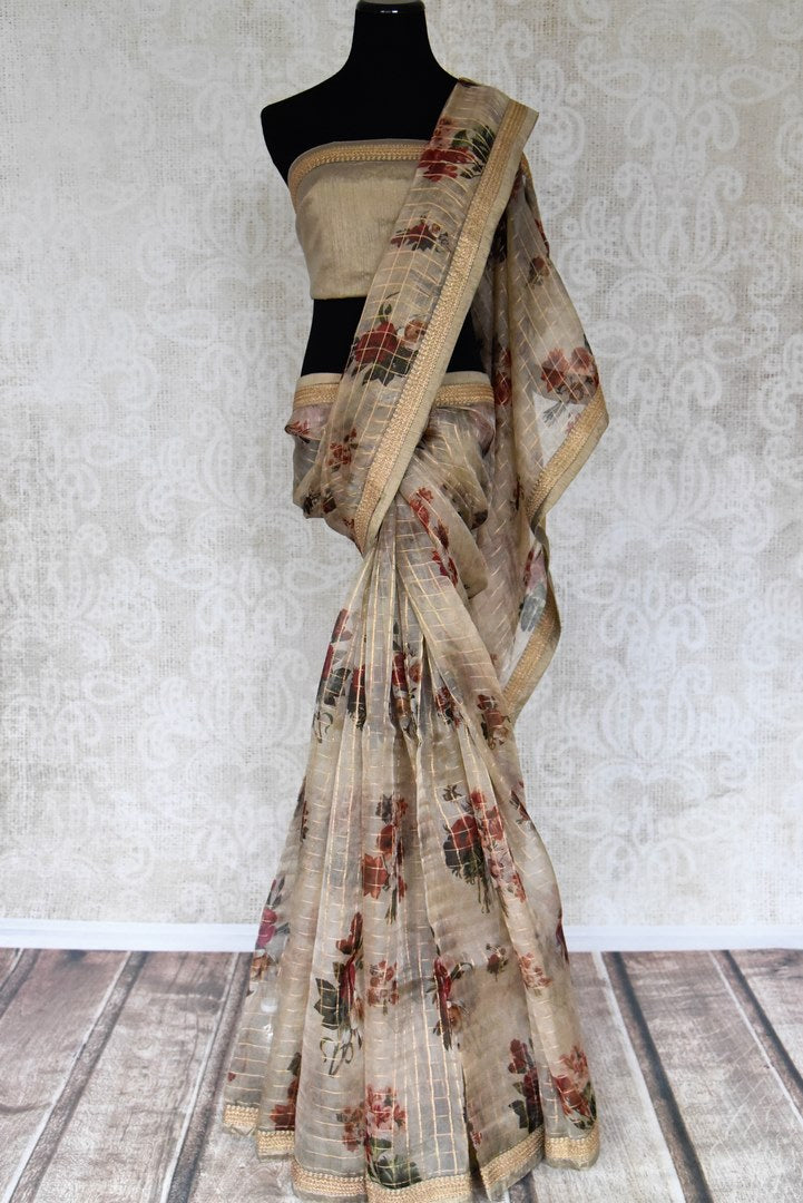 Buy beige floral print zari check kora organza saree online in USA from Pure Elegance. Let your ethnic style be one of a kind with an exquisite variety of Indian designer sarees, pure silk sarees, Bollywood sarees from our exclusive fashion store in USA.-full view
