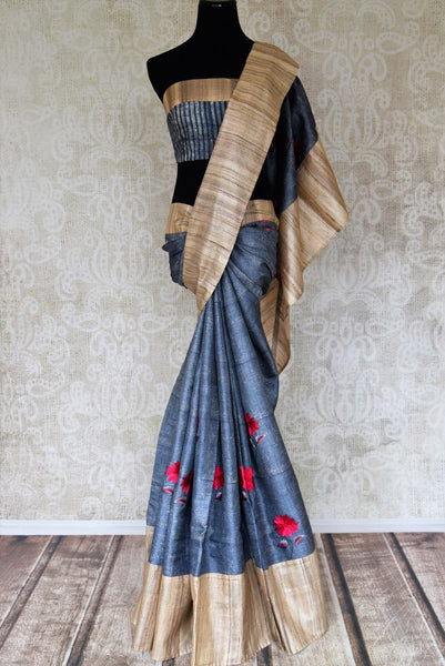 Blue tussar saree for online shopping in USA with embroidered flowers and beige border. Shop from an exquisite collection of handwoven Indian sarees, traditional Banarasi sarees, pure silk sarees for festive and wedding occasion from Pure Elegance Indian clothing store in USA.-full view