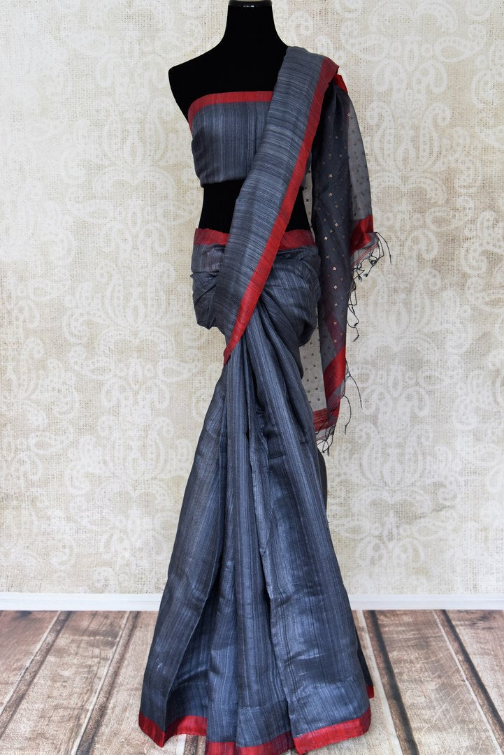 Shop elegant dark blue matka silk saree online in USA with red border. Shine bright on special occasions with traditional Indian sarees, handloom sarees, pure silk sarees in rich colors and designs from Pure Elegance Indian fashion store in USA.-full view