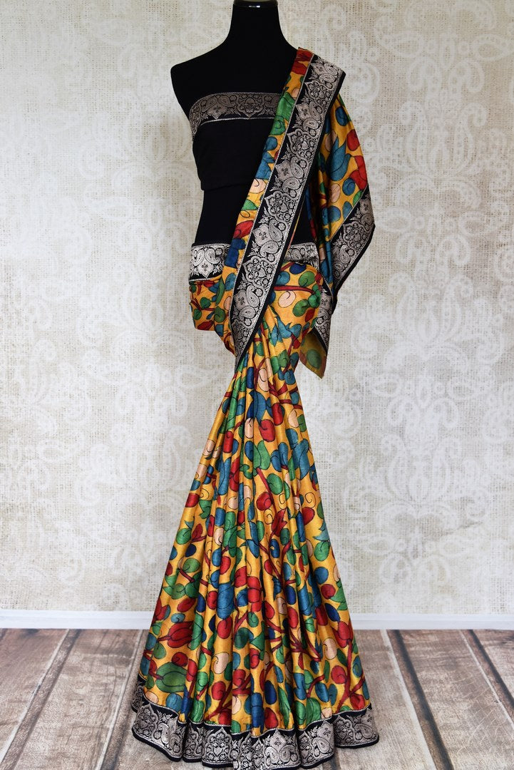 Buy yellow tussar Kalamkari saree online in USA with Banarasi border from Pure Elegance. Let your ethnic style be one of a kind with an exquisite variety of Indian handloom sarees, pure silk sarees, Bollywood sarees from our exclusive fashion store in USA.-full view