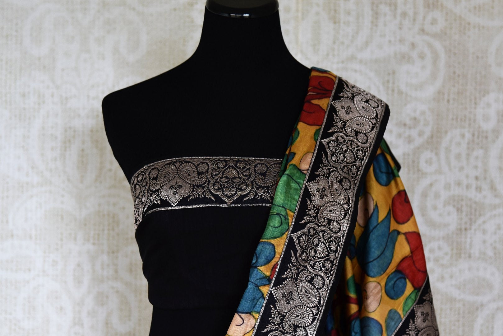 Buy yellow tussar Kalamkari saree online in USA with Banarasi border from Pure Elegance. Let your ethnic style be one of a kind with an exquisite variety of Indian handloom sarees, pure silk sarees, Bollywood sarees from our exclusive fashion store in USA.-blouse pallu