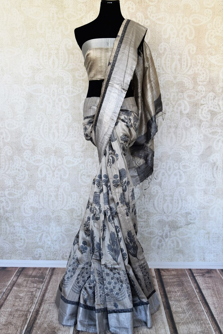 Buy grey printed matka silk sari online in USA with silver border. Enhance your ethnic look with beautiful Indian designer saris from Pure Elegance. Shop from a splendid collection of Banarasi sarees, traditional silk sarees, Kanchipuram silk sarees from our exclusive Indian clothing store in USA.-full view
