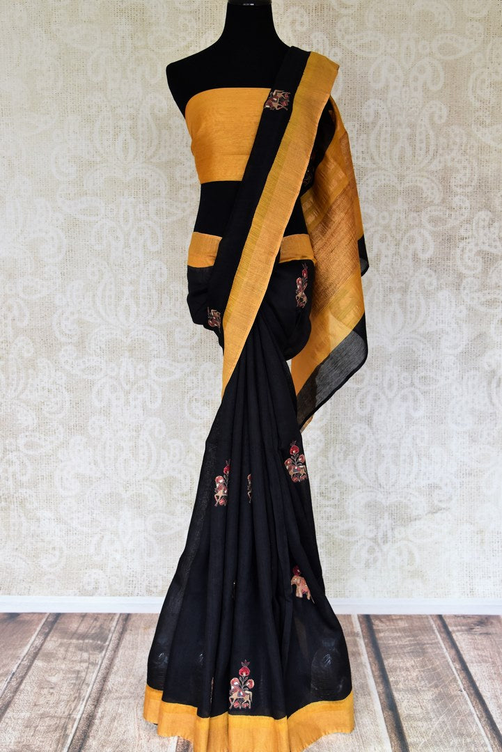 Graceful black applique work matka silk sari for online shopping in USA with mustard border. Shop from an exquisite collection of handwoven Indian sarees, traditional Banarasi saris, pure silk sarees for festive and wedding occasion from Pure Elegance Indian clothing store in USA.-full view