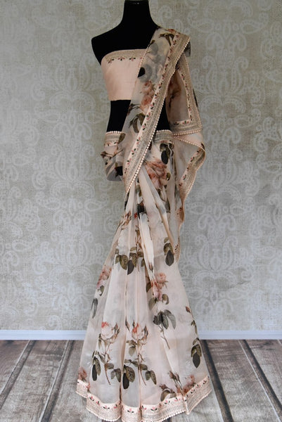 Shop peach printed organza sari with embroidered border online in USA. Be the talk of every occasion in beautiful Indian designer sarees, pure silk sarees, Banarasi saris from Pure Elegance clothing fashion store in USA this wedding season.-full view
