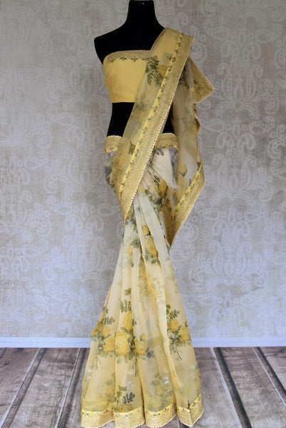 Buy yellow color printed organza sari with embroidered border online in USA. Be the talk of every occasion in beautiful Indian designer sarees, pure silk sarees, Banarasi saris from Pure Elegance clothing fashion store in USA this wedding season.-full view