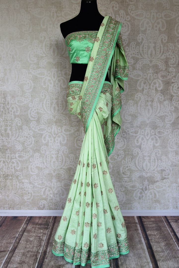 Buy pastel green silk saree with zardozi work online in USA from Pure Elegance. Make your ethnic style perfect with a range of exquisite Indian designer saris with blouses, embroidered sarees, pure handloom sarees available at our exclusive Indian fashion store in USA and also on our online store. Shop now.-full view