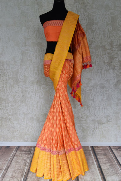 Shop orange Banarasi silk saree with yellow zari border online in USA. Shop more such traditional Banarasi sarees, pure silk sarees, embroidered saris in USA from Pure Elegance clothing fashion store this wedding season.-full view