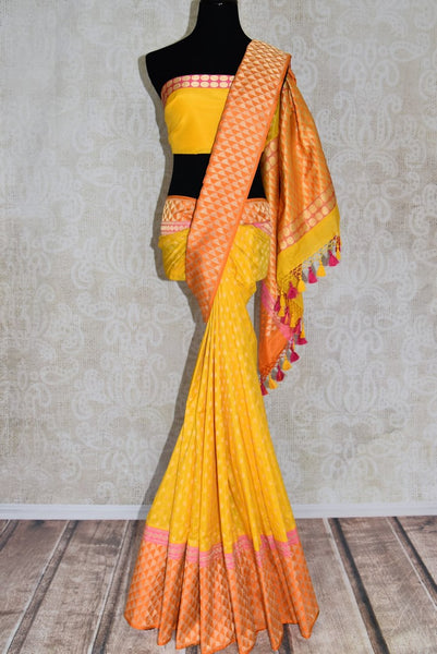 Buy yellow Banarasi silk sari with orange zari border online in USA. Shop more such traditional Banarasi sarees, pure silk sarees, embroidered saris in USA from Pure Elegance clothing fashion store this wedding season.-full view