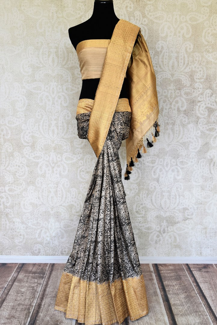 Shop grey and black floral design Banarasi silk sari online in USA with golden zari border. Elevate your traditional style with exquisite Indian handloom sarees from Pure Elegance Indian clothing store in USA. Explore a range of stunning pure silk saris, Banarasi sarees, wedding sarees especially from India for women in USA.-full view