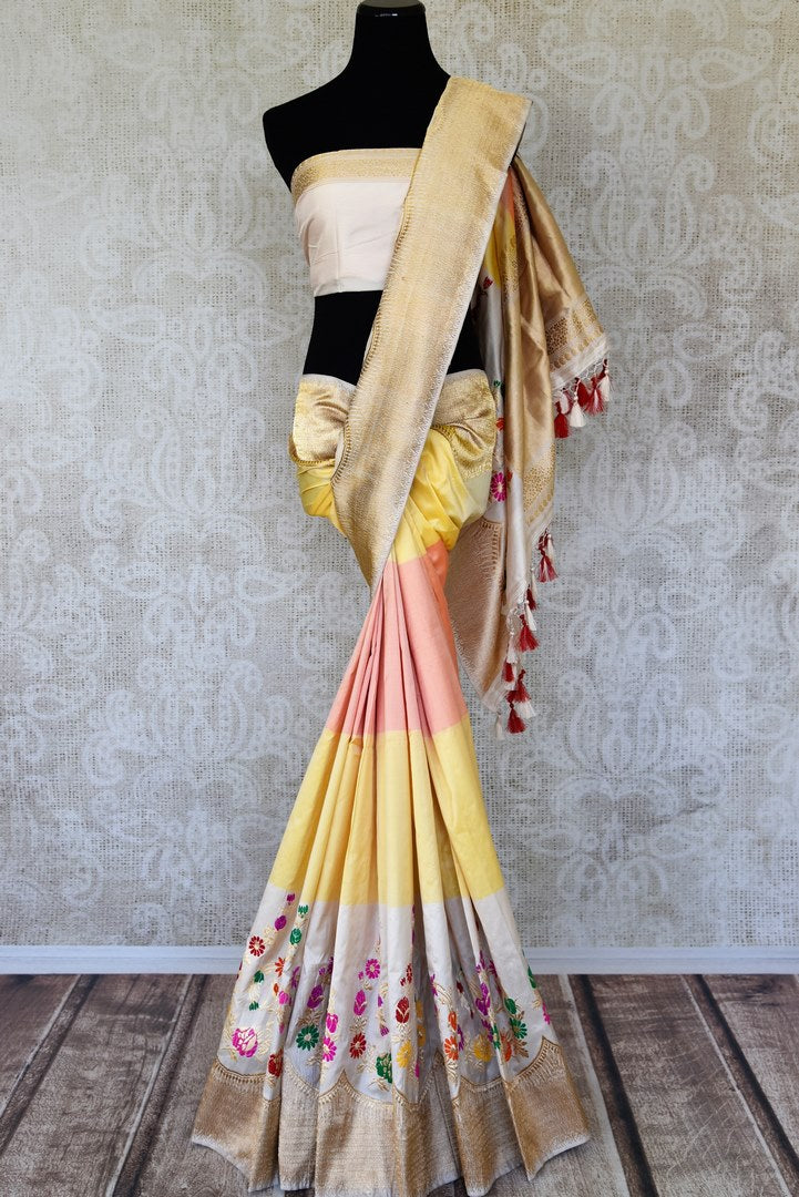 Buy pink yellow cream Banarasi silk sari online in USA with floral minakari zari border. Elevate your traditional style with exquisite Indian handloom sarees from Pure Elegance Indian clothing store in USA. Explore a range of stunning pure silk saris, Banarasi sarees, wedding sarees especially from India for women in USA.-full view