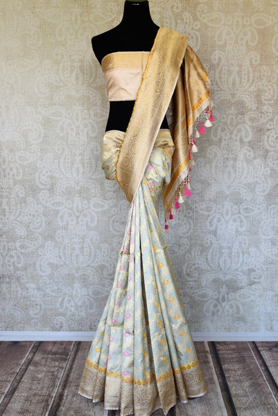 Buy powder blue Banarasi silk sari online in USA with minakari zari creeper design. Elevate your traditional style with exquisite Indian handloom sarees from Pure Elegance Indian clothing store in USA. Explore a range of stunning pure silk saris, Banarasi sarees, wedding sarees especially from India for women in USA.-full view
