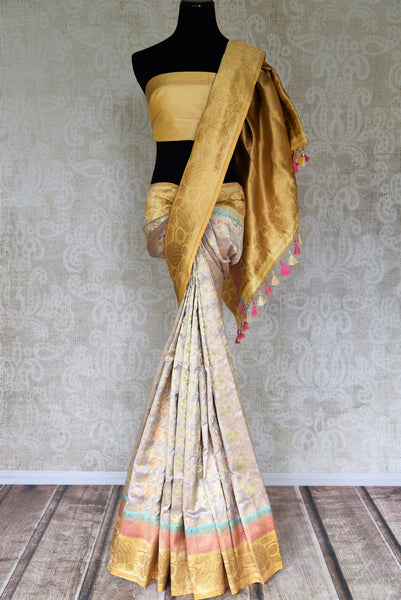 Buy off-white silk saree online in USA with overall zari minakari floral jaal. Shop more such traditional handwoven sarees, pure silk sarees, embroidered saris in USA from Pure Elegance clothing fashion store this wedding season.-full view