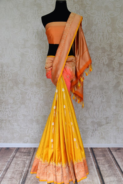 Shop yellow and pink Banarasi silk saree online in USA with orange zari border. Shop more such traditional handwoven sarees, pure silk sarees, embroidered saris in USA from Pure Elegance clothing fashion store this wedding season.-full view