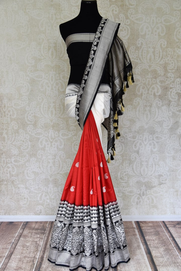 Shop red and white Banarasi silk saree online in USA with black zari border. Shop more such traditional Indian sarees, pure silk sarees, embroidered saris in USA from Pure Elegance clothing fashion store this wedding season.-full view