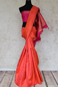 Buy orange Kanjeevaram sari online in USA with jacquard weave and pink zari pallu. Elevate your traditional style with exquisite Indian designer sarees from Pure Elegance Indian clothing store in USA. Explore a range of stunning silk sarees, embroidered sarees, wedding sarees especially from India for women in USA.-full view