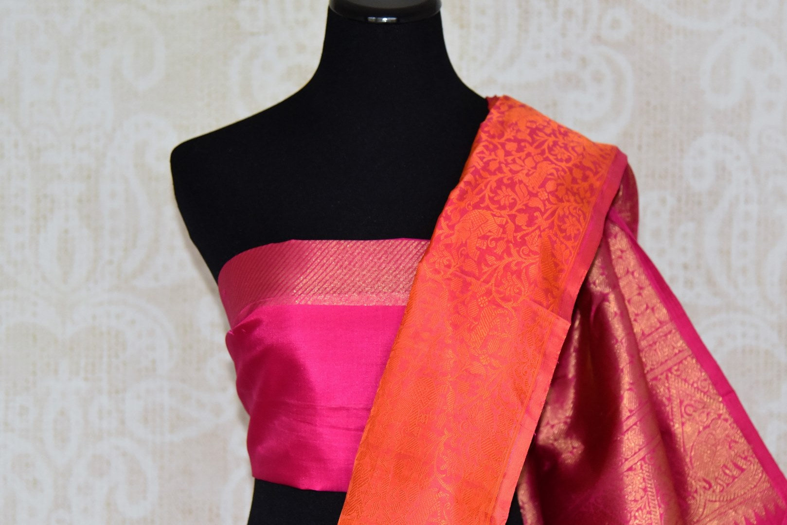 Buy orange Kanjeevaram sari online in USA with jacquard weave and pink zari pallu. Elevate your traditional style with exquisite Indian designer sarees from Pure Elegance Indian clothing store in USA. Explore a range of stunning silk sarees, embroidered sarees, wedding sarees especially from India for women in USA.-blouse pallu
