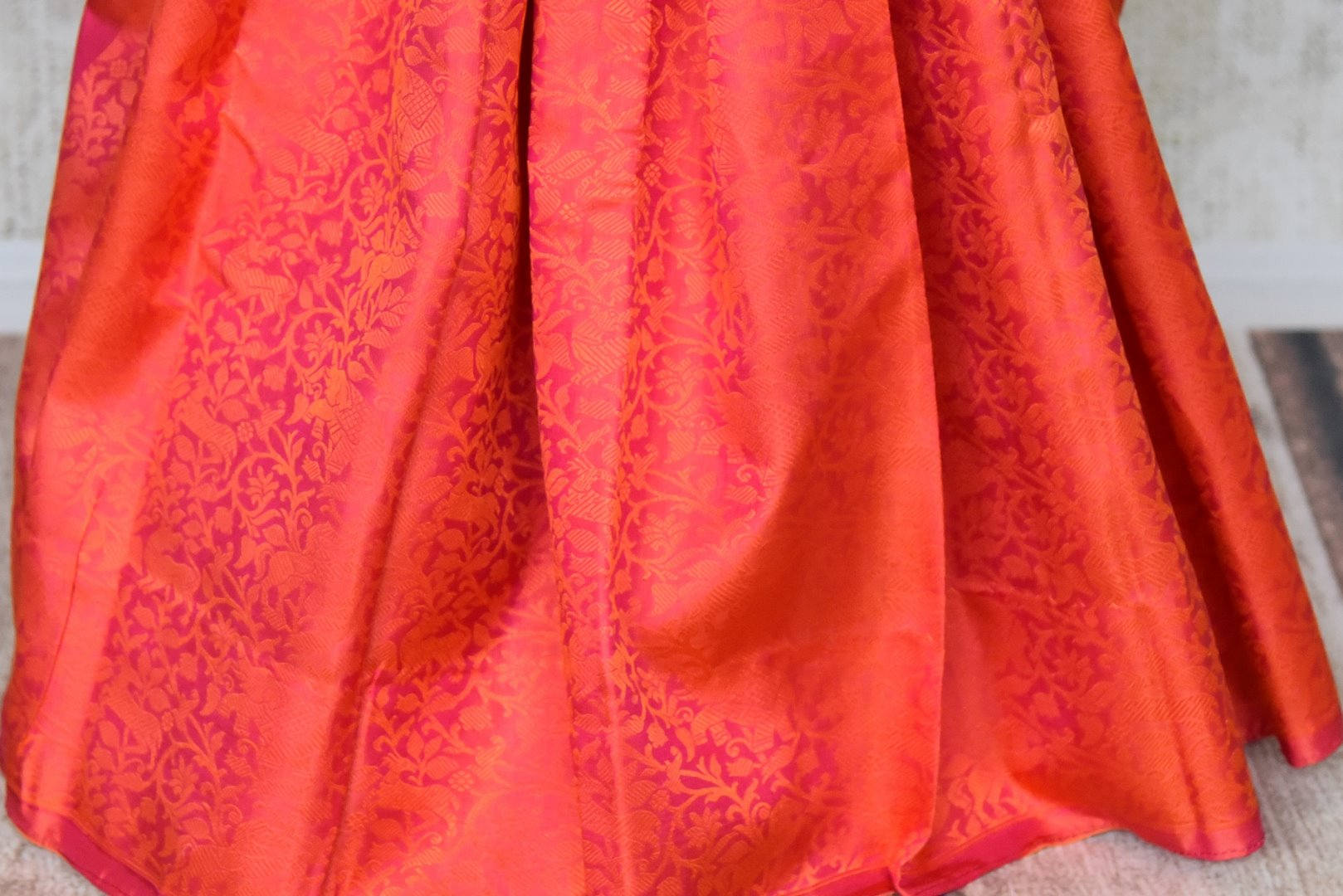 Buy orange Kanjeevaram sari online in USA with jacquard weave and pink zari pallu. Elevate your traditional style with exquisite Indian designer sarees from Pure Elegance Indian clothing store in USA. Explore a range of stunning silk sarees, embroidered sarees, wedding sarees especially from India for women in USA.-pleats