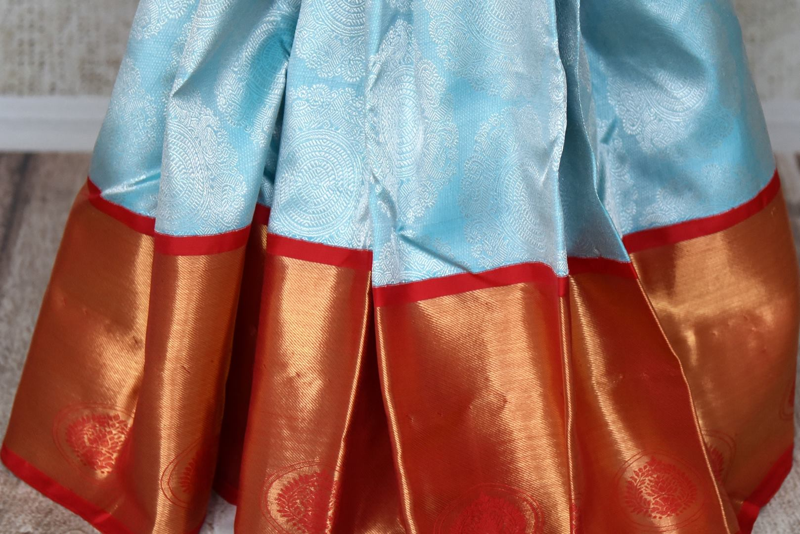 Buy sky blue silver zari saree with red gold zari border online in USA from Pure Elegance. Make your ethnic style perfect with a range of exquisite Indian designer saris with blouses, embroidered sarees, pure handloom sarees available at our exclusive Indian fashion store in USA and also on our online store. Shop now.-pleats