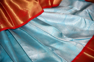 Buy sky blue silver zari saree with red gold zari border online in USA from Pure Elegance. Make your ethnic style perfect with a range of exquisite Indian designer saris with blouses, embroidered sarees, pure handloom sarees available at our exclusive Indian fashion store in USA and also on our online store. Shop now.-details