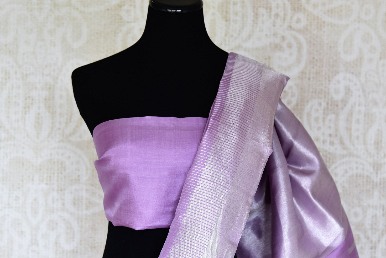 Shop lavender Kanjeevaram sari with silver zari border online in USA. Shop more such exquisite Indian sarees in USA from Pure Elegance. Get floored by a range of designer sarees, Kanchipuram silk saris at our Indian fashion store in USA.-blouse pallu
