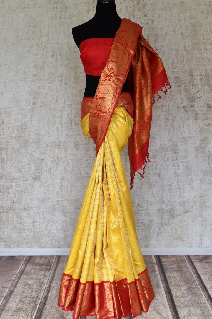 Buy yellow Kanchipuram silk sari with red zari border online in USA from Pure Elegance. Make your ethnic style perfect with a range of exquisite Indian designer saris with blouses, embroidered sarees, pure handloom sarees available at our exclusive Indian fashion store in USA and also on our online store. Shop now.-full view