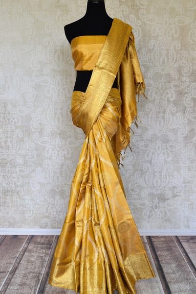 Shop yellow Kanchipuram saree with zari border and zari buta online in USA from Pure Elegance. Make your ethnic style perfect with a range of exquisite Indian designer saris with blouses, embroidered sarees, Kanchipuram silk sarees available at our exclusive Indian fashion store in USA and also on our online store. Shop now.-full view
