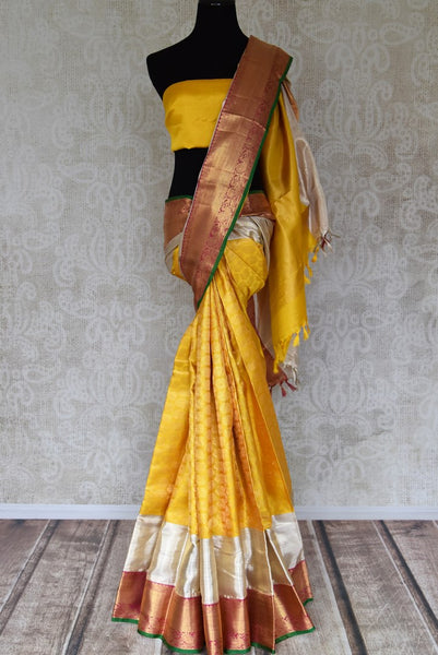 Shop yellow Kanchipuram sari with white and pink zari border online in USA from Pure Elegance. Make your ethnic style perfect with a range of exquisite Indian designer saris with blouses, embroidered sarees, Kanchipuram silk sarees available at our exclusive Indian fashion store in USA and also on our online store. Shop now.-full view
