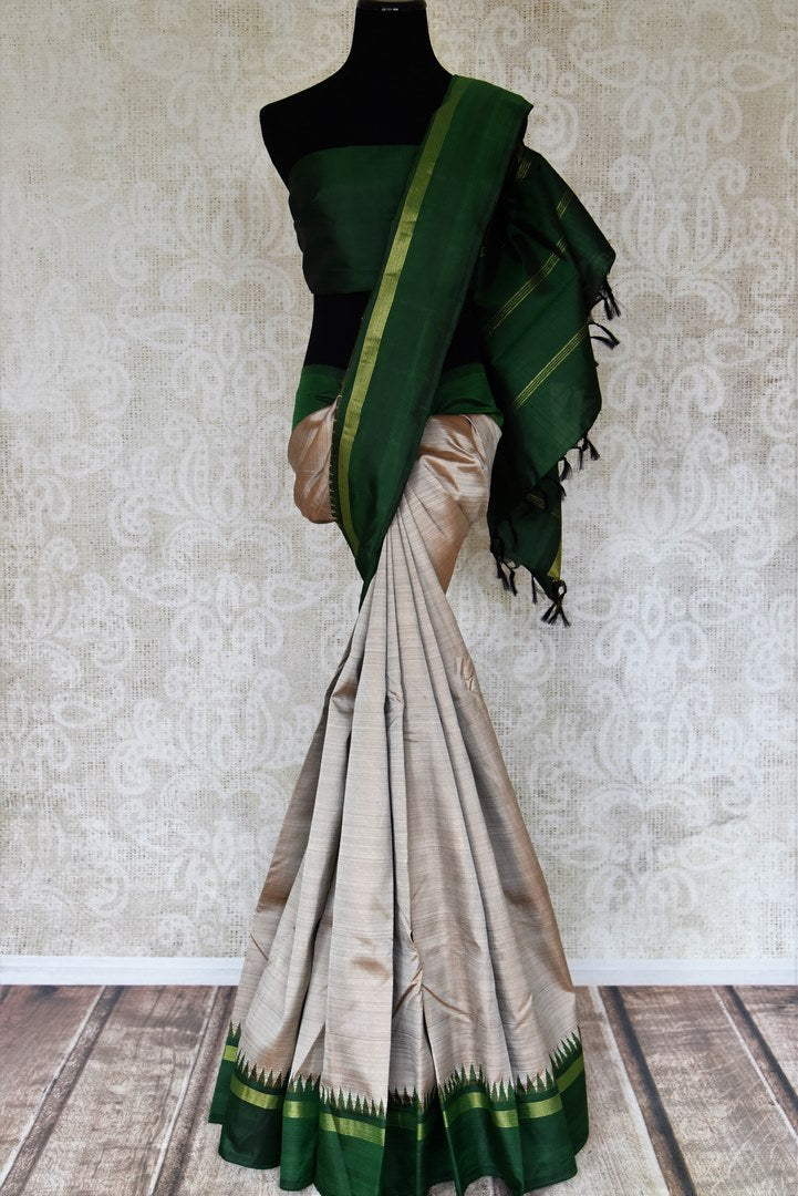 Buy grey Kanjeevaram saree online in USA with bottle green border and pallu. Elevate your traditional style with exquisite Indian designer sarees from Pure Elegance Indian clothing store in USA. Explore a range of stunning silk sarees, embroidered sarees, wedding sarees especially from India for women in USA.-full view
