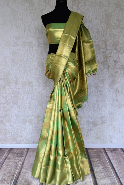 Buy golden green Kanchipuram saree with beautiful zari work online in USA from Pure Elegance. Make your ethnic style perfect with a range of exquisite Indian designer saris with blouses, embroidered sarees, Kanjivaram silk saris available at our exclusive Indian fashion store in USA and also on our online store. Shop now.-full view