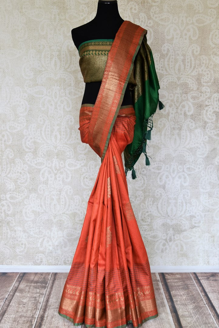 Gorgeous orange tussar Banarasi saree for online shopping in USA with zari border and green zari pallu. Shop from an exquisite collection of handwoven Indian sarees, traditional Banarasi saris, pure silk sarees for festive and wedding occasion from Pure Elegance Indian clothing store in USA.-full view