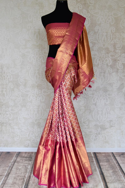 Shop pink Kanjeevaram saree with overall zari work online in USA from Pure Elegance. Make your ethnic style perfect with a range of exquisite Indian designer saris with blouses, embroidered sarees, Kanjivaram silk saris available at our exclusive Indian fashion store in USA and also on our online store. Shop now.-full view
