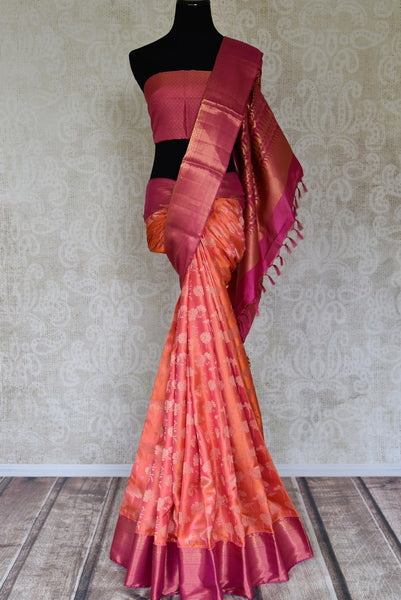 Shop orange Kanjivaram saree online in USA with pink zari border. Flaunt the best of Indian styles on special occasions with Indian Kanjeevaram saris, handloom silk sarees, embroidered sarees from Pure Elegance Indian fashion store in USA.-full view