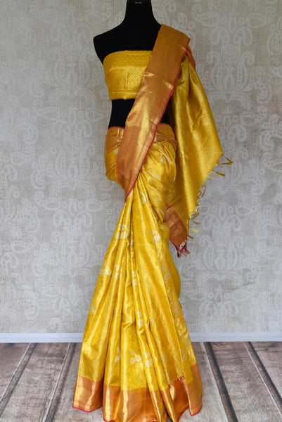 Buy yellow color Kanjeevaram saree with dancing figures and instrument zari buta online in USA from Pure Elegance. Make your ethnic style perfect with a range of exquisite Indian designer saris with blouses, embroidered sarees, Kanjivaram silk saris available at our exclusive Indian fashion store in USA and also on our online store. Shop now.-full view
