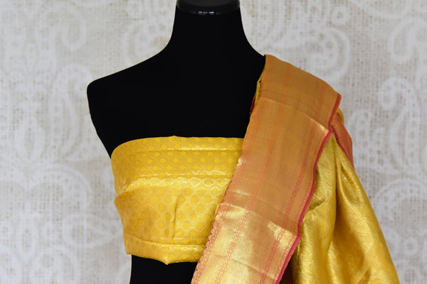 Buy yellow color Kanjeevaram saree with dancing figures and instrument zari buta online in USA from Pure Elegance. Make your ethnic style perfect with a range of exquisite Indian designer saris with blouses, embroidered sarees, Kanjivaram silk saris available at our exclusive Indian fashion store in USA and also on our online store. Shop now.-blouse pallu