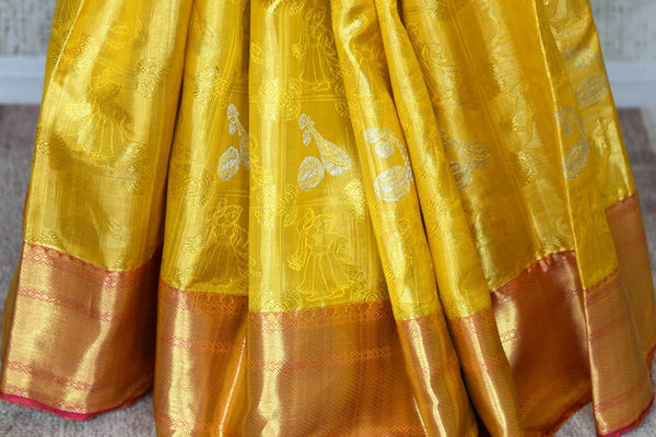 Buy yellow color Kanjeevaram saree with dancing figures and instrument zari buta online in USA from Pure Elegance. Make your ethnic style perfect with a range of exquisite Indian designer saris with blouses, embroidered sarees, Kanjivaram silk saris available at our exclusive Indian fashion store in USA and also on our online store. Shop now.-pleats