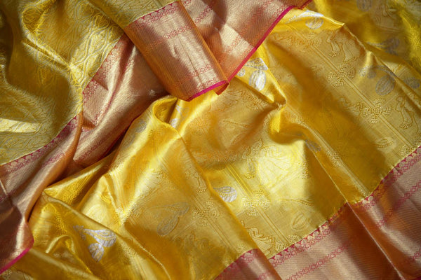 Buy yellow color Kanjeevaram saree with dancing figures and instrument zari buta online in USA from Pure Elegance. Make your ethnic style perfect with a range of exquisite Indian designer saris with blouses, embroidered sarees, Kanjivaram silk saris available at our exclusive Indian fashion store in USA and also on our online store. Shop now.-details