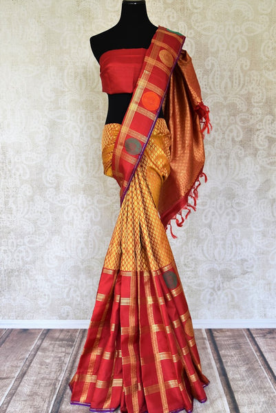 Buy mustard Kanchipuram online in USA with zari buta and red zari check border. Flaunt the best of Indian styles on weddings and special occasions with Indian Kanchipuram silk sarees, designer silk saris, embroidered sarees from Pure Elegance Indian clothing store in USA.-full view