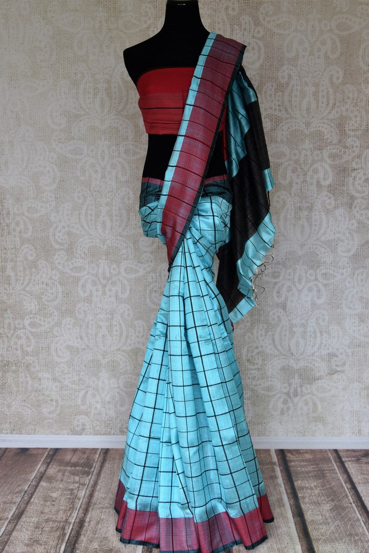 Buy sky blue check matka silk saree online in USA with red border. Elevate your traditional style with exquisite Indian handloom sarees from Pure Elegance Indian clothing store in USA. Explore a range of stunning  Kanchipuram silk saris, embroidered sarees, wedding sarees especially from India for women in USA.-full view
