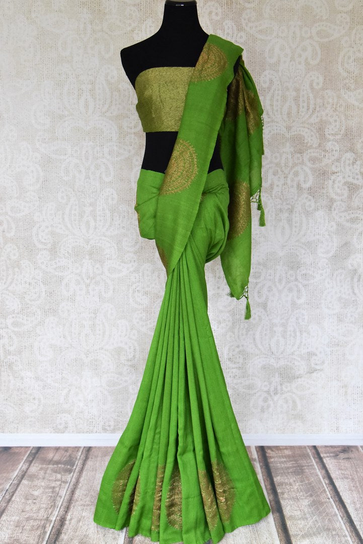Buy beautiful green muga silk saree online in USA with big floral chakra zari buta. Dazzle on special occasions in ethnic wear from Pure Elegance. Explore a range of exquisite Indian designer sarees, pure silk saris, handwoven sarees at our exclusive Indian fashion store in USA.-full view