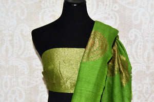 Buy beautiful green muga silk saree online in USA with big floral chakra zari buta. Dazzle on special occasions in ethnic wear from Pure Elegance. Explore a range of exquisite Indian designer sarees, pure silk saris, handwoven sarees at our exclusive Indian fashion store in USA.-blouse pallu