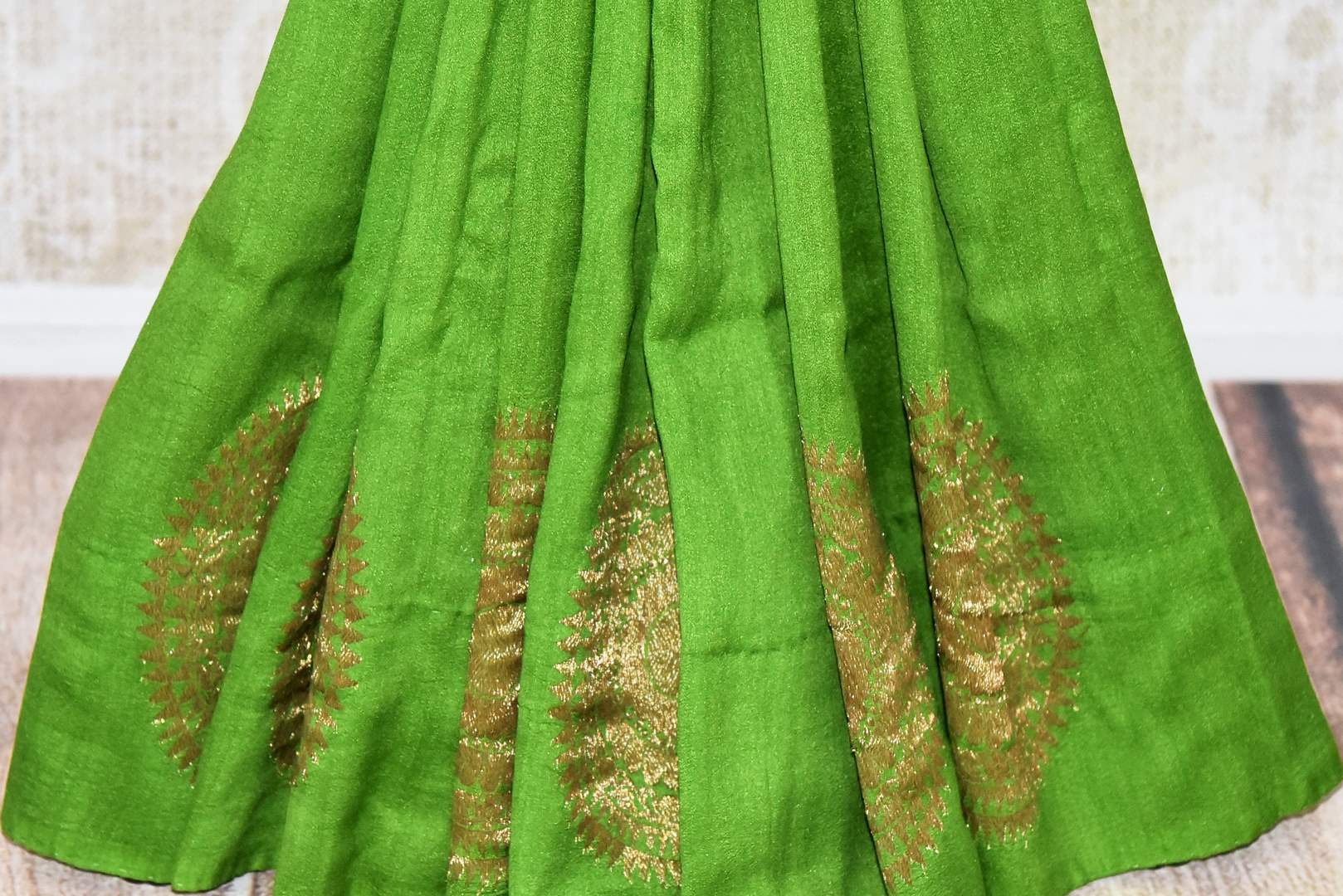Buy beautiful green muga silk saree online in USA with big floral chakra zari buta. Dazzle on special occasions in ethnic wear from Pure Elegance. Explore a range of exquisite Indian designer sarees, pure silk saris, handwoven sarees at our exclusive Indian fashion store in USA.-pleats