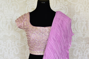 Shop mauve crinkled georgette saree with silk embroidered blouse online in USA from Pure Elegance. Make your ethnic style perfect with a range of exquisite Indian designer sarees with blouses, embroidered sarees, wedding sarees available at our exclusive Indian fashion store in USA and also on our online store. Shop now.-blouse pallu