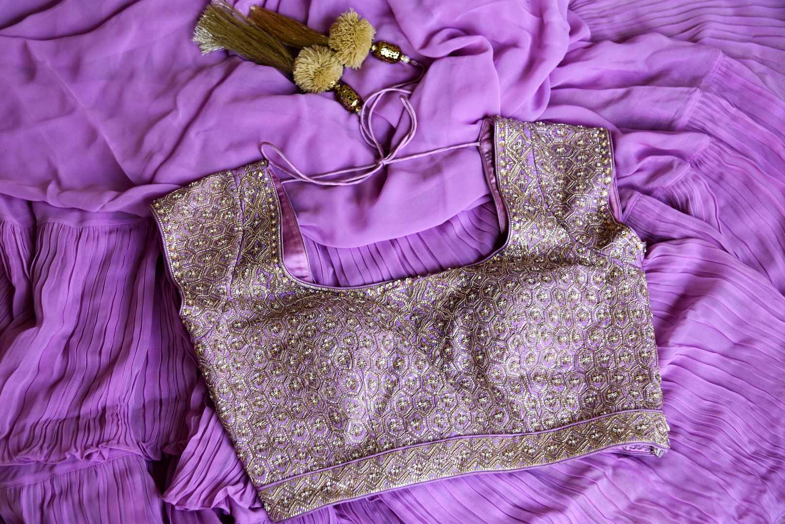 Shop mauve crinkled georgette saree with silk embroidered blouse online in USA from Pure Elegance. Make your ethnic style perfect with a range of exquisite Indian designer sarees with blouses, embroidered sarees, wedding sarees available at our exclusive Indian fashion store in USA and also on our online store. Shop now.-details