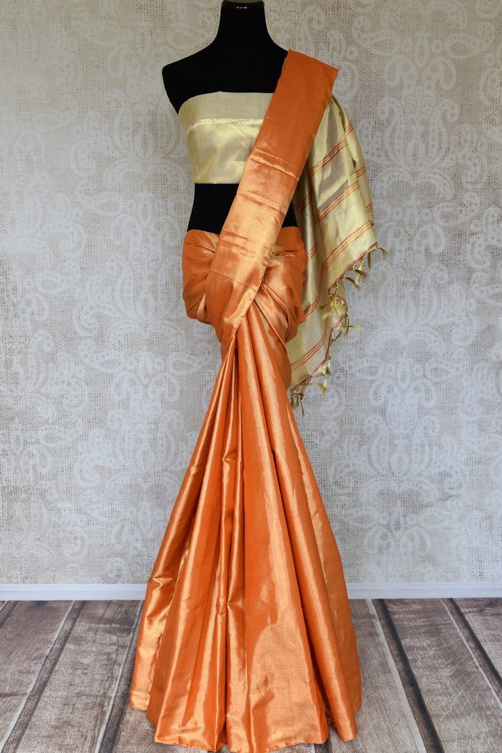 Shop golden orange Kanjeevaram sari online in USA with cream pallu. Shop more such exquisite Indian saris in USA from Pure Elegance. Get floored by a range of designer sarees, Kanchipuram silk saris at our Indian fashion store in USA.-full view