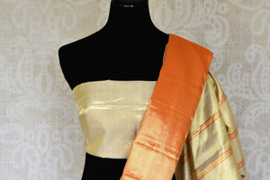 Shop golden orange Kanjeevaram sari online in USA with cream pallu. Shop more such exquisite Indian saris in USA from Pure Elegance. Get floored by a range of designer sarees, Kanchipuram silk saris at our Indian fashion store in USA.-blouse pallu