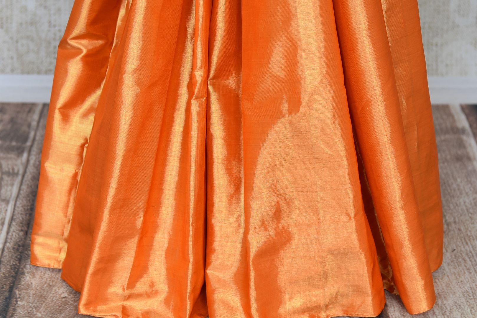 Shop golden orange Kanjeevaram sari online in USA with cream pallu. Shop more such exquisite Indian saris in USA from Pure Elegance. Get floored by a range of designer sarees, Kanchipuram silk saris at our Indian fashion store in USA.-pleats
